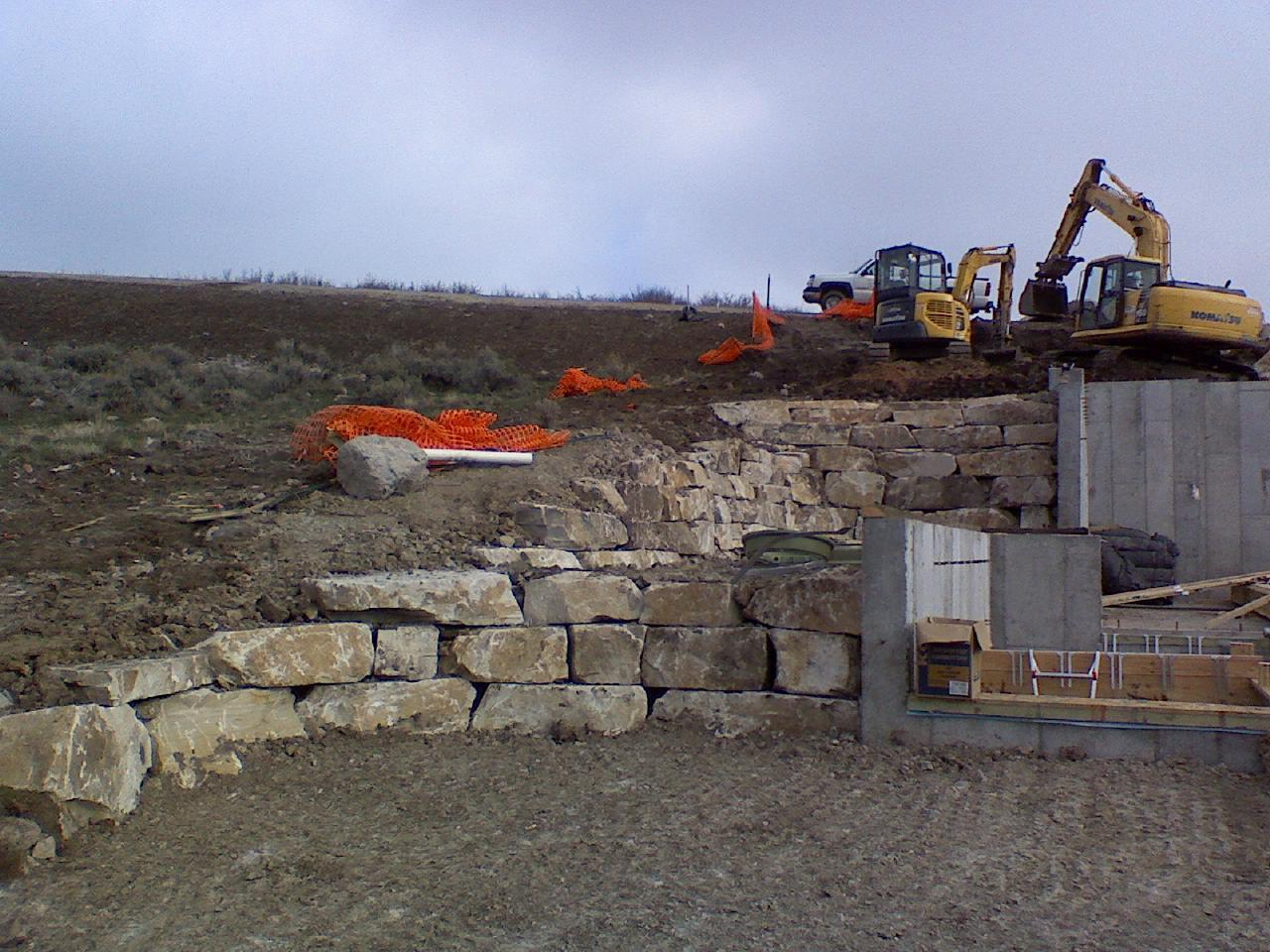 Rock walls & site work for a custom home in Promontory Point